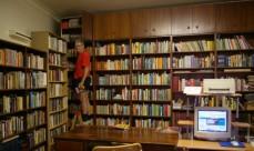 Errol Collen in his library.
