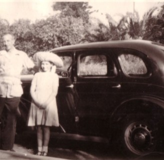 David and Jean Campbell with the Prefect on the way to Warner Beach, Natal