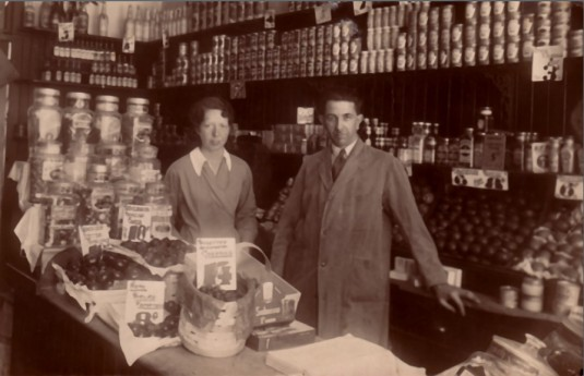 Father and Helen in the shop in Springburn before the war.